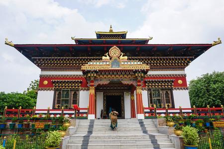 ordain: Bodhgaya, India - July 22, 2015. Color paintings traditional Bhutanese Buddhist temple in Bodhgaya, India.