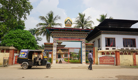 bodhgaya: Bodhgaya, India - July 22, 2015. The tuk-tuk parking at the main gate of traditional Bhutanese Buddhist temple in Bodhgaya, India. Editorial