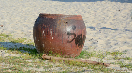 holy jug: Clay pot on the beach in Vung Tau, Vietnam. Stock Photo