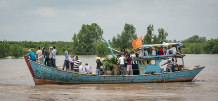 can tho: Can Tho, Vietnam - Oct 12, 2015. The motorboat carrying many people on Mekong river. Mekong Delta is by far Vietnams most productive region in agriculture. Editorial