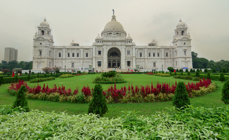 water feature: Kolkata, India - June 22, 2015. People visit the Victoria Memorial and its reflection in the water feature in the foreground. Built by the British during colonial times it is a prominent feature in Kolkata.
