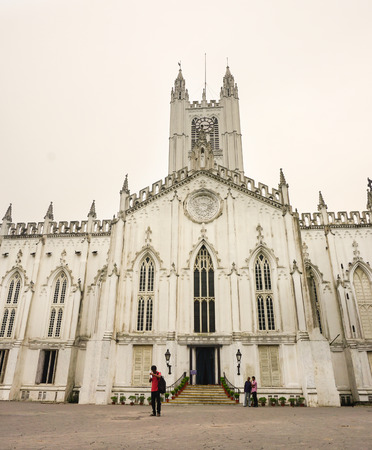 notable: Kolkata, India - Aug 2, 2015. People visit Saint Pauls Cathedral of Kolkata, India. Landmark Anglican church completed in 1847, with restored steeple and notable stained glass windows.