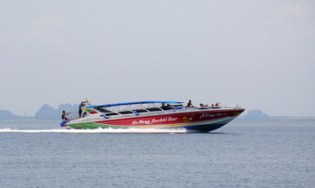 speedboats: Krabi, Thailand - Sep 12, 2015. The speedboats and tourists on the beautiful sea in sunny day in Krabi. Tourism is an important industry in Southern Thailand.