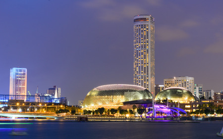 extensive: Singapore - Oct 10, 2015. Night view of business district in Singapore. Trade in Singapore has benefited from the extensive network of trade agreements Singapore has passed.