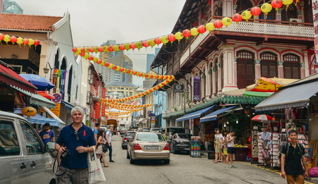 considerably: Singapore - Aug 30, 2015. Old buildings in Chinatown of Singapore. As the largest ethnic group in Singapore is Chinese, Chinatown is considerably less of an enclave than it once was.