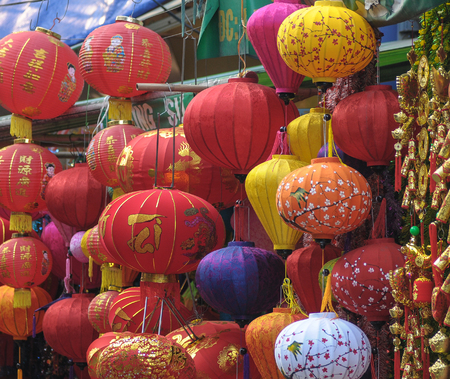important people:  Vietnamese people sell Tet decorations on the street in Hanoi, Vietnam. Tet is the most important holidays of the people of Vietnam.