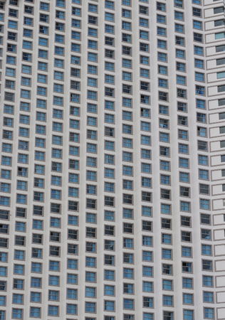 many windows: Architectural detail of a modern building with many windows. Stock Photo