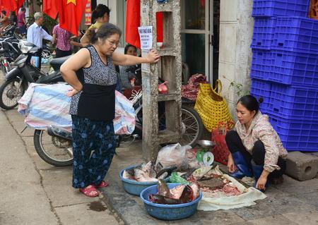 categorize: Nha Trang, Vietnam - Nov 1, 2015. People selling fish and seafood in the street market, Nha Trang, Vietnam.