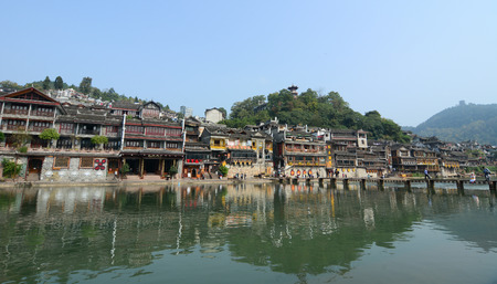 tentative: HUNAN, CHINA - OCT 22, 2015. Old houses located at Fenghuang county in Hunan, China. The ancient town of Fenghuang, Tentative List in the Cultural category. Editorial