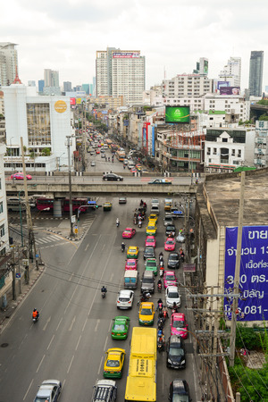 congested: BANGKOK, THAILAND - OCT 22, 2015. Traffic moves slowly along a busy road in Bangkok, Thailand. Annually an estimated 150,000 new cars join the already heavily congested streets of Bangkok.