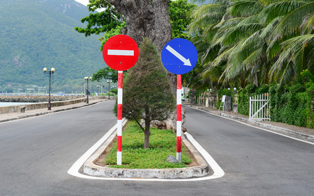 con dao: Con Dao road - the famous road which leads along the coastline mountains in Con Dao island, Vietnam. Beautiful nature and transportation background.