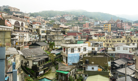 jiufen: Jiufen,Taiwan - March 17, 2015. Hillside houses in Jiufen Taiwan, people can seen walking and exploring around it. Editorial