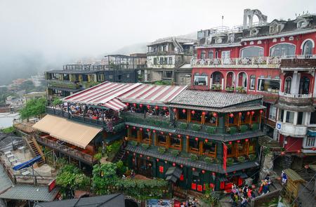 jiufen: Jiufen,Taiwan - March 17, 2015. Hillside tea houses in Jiufen Taiwan, people can seen walking and exploring around it.