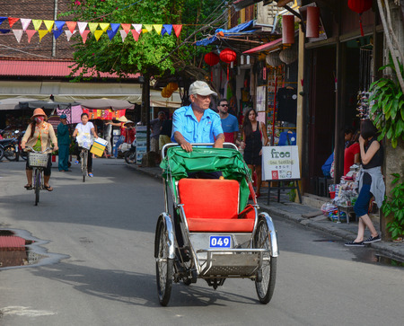world cultural heritage: Hoi An, Vietnam - Jun 20, 2015. A cyclo on the street in Hoi An ancient town. Hoi An is a world cultural heritage. Editorial