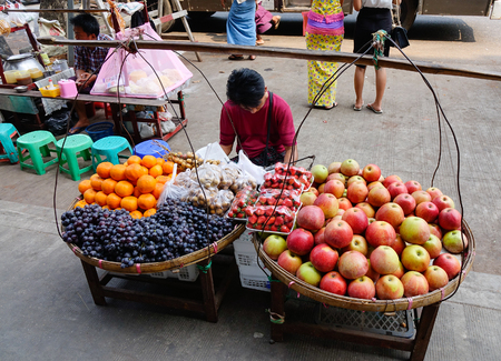 recently: Yangon, Myanmar - Feb 28, 2016. Street life in Yangon, Myanmar. Yangon is no longer the capital of Myanmar, but it has experienced a huge increase in tourism recently.