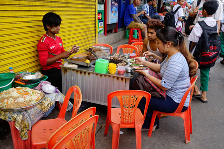 Yangon, Myanmar - Feb 28, 2016. Street life in Yangon, Myanmar. Yangon is no longer the capital of Myanmar, but it has experienced a huge increase in tourism recently.