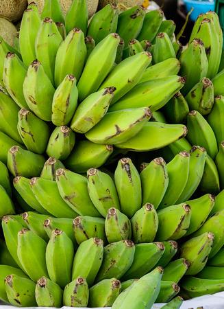Heap of green banana at the Asian market.