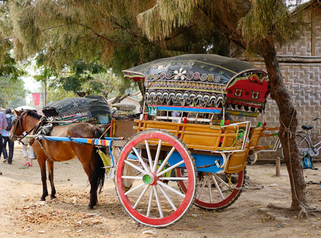 horse cart: Mandalay, Myanmar - Feb 22, 2016. A horse cart parking on rural road at Innwa village in Mandalay, Myanmar.