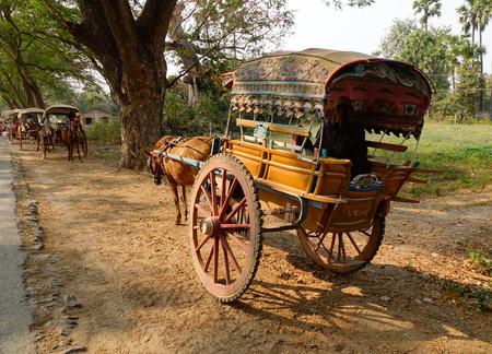 rikscha: Mandalay, Myanmar - Feb 22, 2016. Horse carts parking on rural road in Mandalay, Myanmar.