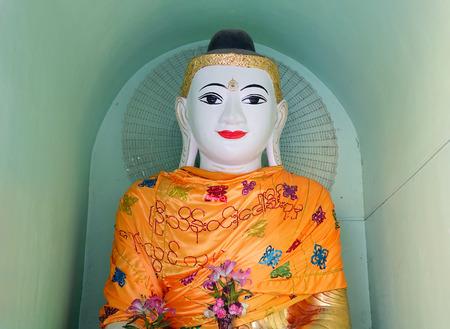 White Buddha statue in Shwedagon Paya in Yangon, Myanmar.