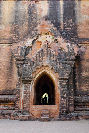 People praying at the Buddhist temple in Bagan, Myanmar. Stock Photo