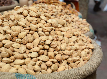 Dried almonds for sale at local market in Old Delhi, India. Stock Photo
