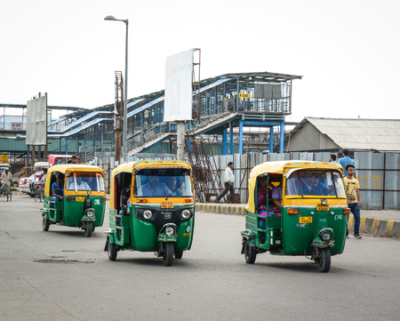 autorick: Delhi, India - Jul 26, 2015. Private auto rickshaw three-weeler tuk-tuk taxi drives down the street in Kolkata. Indian three-wheelers have the design of the Piaggio Ape C, from 1948.