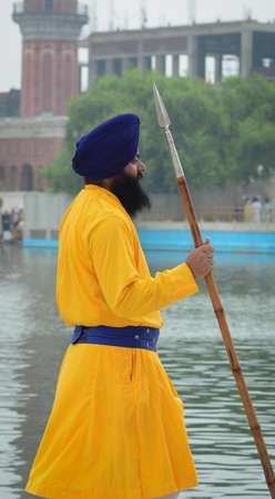 Amritsar, India - Jul 25, 2015. Portrait of Sikh guard with a spearhead at the Golden Temple in Amritsar, India. Editorial