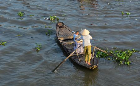 Soc Trang, Vietnam - Feb 2, 2016. A woman rowing wooden boat on Nga Nam river in Soc Trang, southern Vietnam. Nga Nam is one of famous market in southern Vietnam.