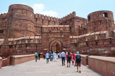 Agra, India - Jul 13, 2015. People coming to the Agra Fort, World Heritage site. The fort was built by the Mughals, can be more accurately described as a walled city in Agra, India.