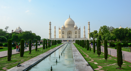 Agra, India - Jul 13, 2015. Taj Mahal with the garden in Agra, India. It is one of the worlds most celebrated structures and a symbol of Indias rich history.