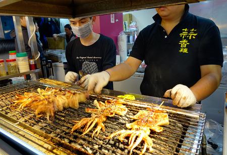 Taipei, Taiwan - Jan 5, 2016. People selling foods at night market in Taipei, Taiwan.