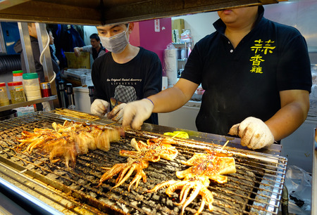 Taipei, Taiwan - Jan 5, 2016. People selling foods at night market in Taipei, Taiwan.