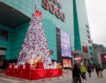 Taipei, Taiwan - Jan 7, 2016. People looking at the Christmas tree in Sogo Shopping Mall at Tamsui district in Taipei, Taiwan.