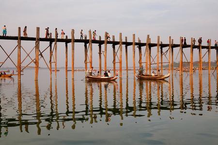 teakwood: Mandalay, Myanmar - Feb 20, 2016. People visit the Ubein bridge in Mandalay, Myanmar. Ubein is believed to be the oldest and longest teakwood bridge in the world. Editorial