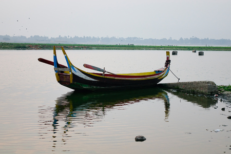 Lonely boat on the lake in Mandalay, Myanmar