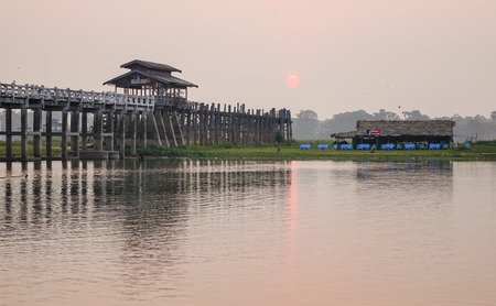 Lake scene with the Ubein bridge in Mandalay, Myanmar. Ubein was built around 1850 and is believed to be the oldest and longest teakwood bridge in the world.