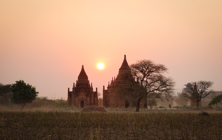 nascent: Buddhist temples at sunrise in Bagan, Myanmar. The Bagan Archaeological Zone is a main draw for the countrys nascent tourism industry.