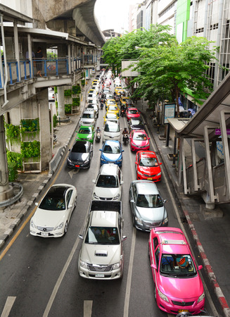BANGKOK, THAILAND - JUL 31, 2015. Traffic nears gridlock on a busy road in the city centre in Bangkok, Thailand. Annually an estimated 150,000 new cars join the heavily congested roads of Bangkok.