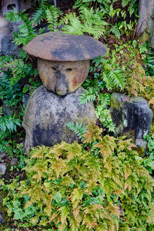 Decorations In Japanese Garden With A Statue On The Grass. Stock Photo    66002548