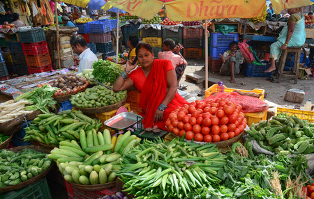 Bodhgaya, India - Jul 9, 2015. Unidentified people selling vegetables in a crowded market in Bodhgaya, India. Its a common practice in India to sell vegetables in open markets and streets.