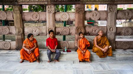 Bodhgaya, India - Jul 9, 2016. Monk sitting at Mahabodhi Temple in Bodhgaya, India.