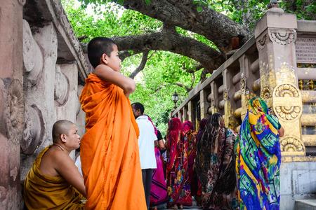 Bodhgaya, India - Jul 9, 2016. Monks with prayers walking at Mahabodhi Temple in Bodhgaya, India. Editorial