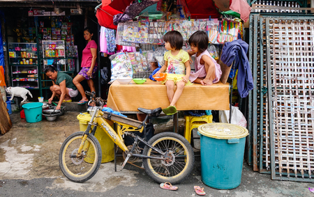 Manila, Philippines - Dec 20, 2015. Children playing at slum region in Manila, Philippines. Manila is a Philippines capital with very strong contrasts in standard of living.