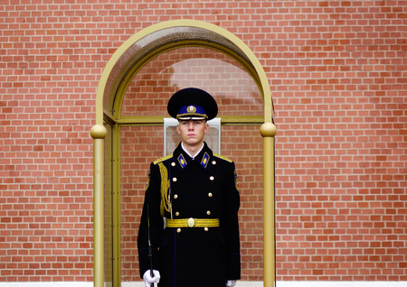 tomb unknown soldier: Moscow, Russia - Oct 4, 2016. Unidentified guard stands at the Tomb of the Unknown Soldier in Moscow, Russia. Tomb is dedicated to the Soviet soldiers killed during World War II.