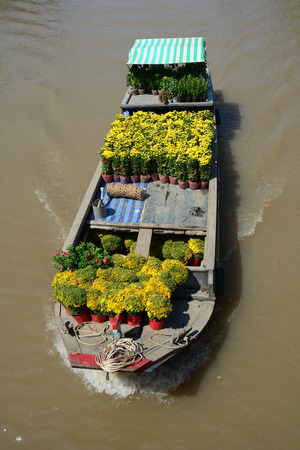A cargo boat running on the Mekong river at sunny day in Mekong Delta, southern Vietnam. The Mekong is a trans-boundary river in Southeast Asia.