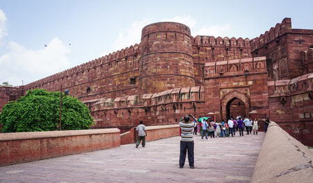 Agra, India - Jul 13, 2015. People visit Agra Fort at the sunny day. The fort was built by the Mughals, can be more accurately described as a walled city in Agra, India. Editorial
