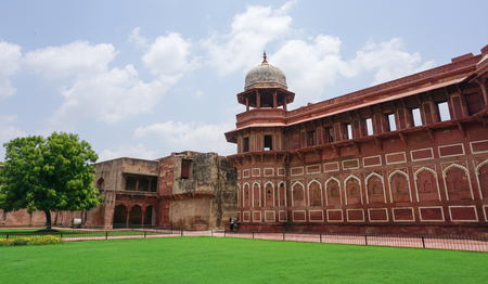 Agra, India - Jul 13, 2015. View of Agra Fort with grass ground at the sunny day. The fort was built by the Mughals, can be more accurately described as a walled city in Agra, India. Editorial