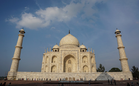 Agra, India - Jul 13, 2015. Indian people visit Taj Mahal with blue sky in Agra, India. It is one of the worlds most celebrated structures and a symbol of Indias rich history. Editorial