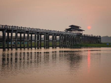 View of the Ubein bridge in Mandalay, Myanmar. Ubein was built around 1850 and is believed to be the oldest and longest teakwood bridge in the world. Stock Photo